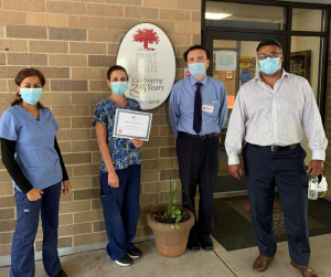 Pictured in the photo from left to right: Diane Azeez, DNS, Jennifer Spigarolo, Infection Preventionist, Michael Chiappinelli, Administrator, and Dr. Desilva, Medical Director.